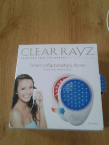 Acne treatment blue and red lights for healing of face