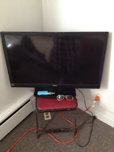 32 inch flat screen with 380 dollar Ray bans trade me