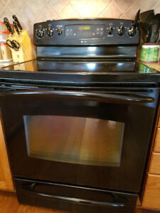 For Sale  black GE Profile Stove and matching Microwave