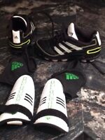 Boys size 11 soccer cleats and shin pads Adidas