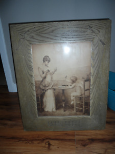 print of lady with Cupid in wood frame with carving of bow&arrow