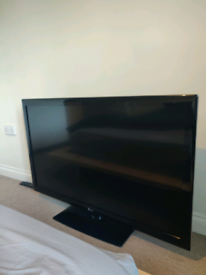 """LG 47"""" HD TV with stand."""