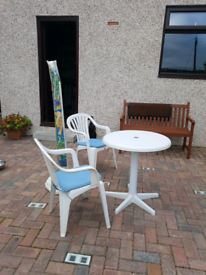 Patio table chairs and parasol