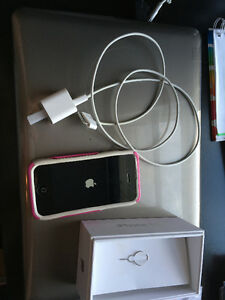 iphone 4s with charger, pin key, and pink otter box case