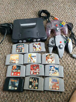 N64 bundle with 2 controllers, all cables, and 11 games