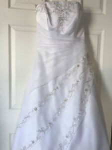 Unworn, stunning wedding dress. Tags attached.