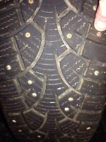4 studded winter tires like new