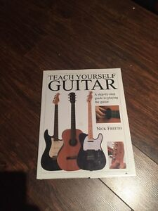 Teach yourself guitar hard cover book