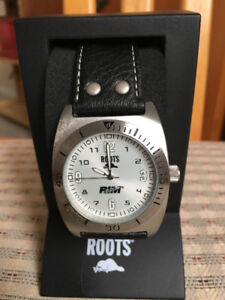 New in case Roots leather band watch