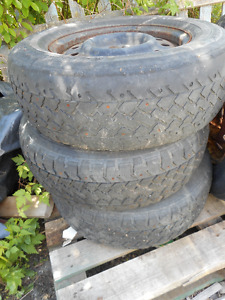 3 STUDDED TIRES P215/70R15