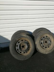 4 Winter Tires - Studded on rims