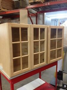 Maple wall cabinets with glass doors.
