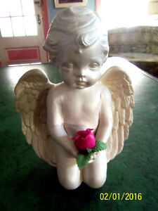CUPID HOLDING ROSE -- HAVE ROMANTIC DINNER WITH YOUR SIGNIFICANT London Ontario image 1