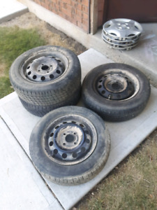 4 used R14 tires, rims, and hubcaps