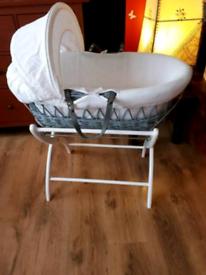 Moses basket set. Lovely padded sides. Hardly used. Izziwotnot