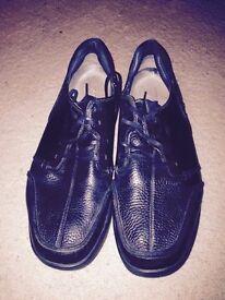 Black leather men's MBT shoes