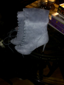 Thigh high baby blue boots.