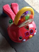 Musical fisher price ride and push toy