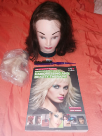 Hairdressing head with attachments, book