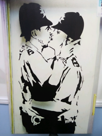 "Banksy canvass of his famous ""kissing coppers"" art in Brighton"