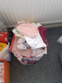 Bag full of girl clothes size 12-18 months along with a few 18-24