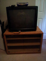TV, TV stand, DVD player and 2 remotes