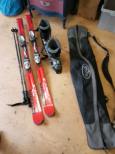 Downhill skis boots poles and bag