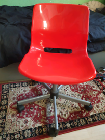 Red plastic chair from IKEA