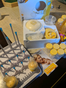 Medela Swing breast pump. Awesome deal!