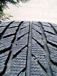 Set of 4 Toyo Garit KX Winter tires 205/55R16 on Volvo rims
