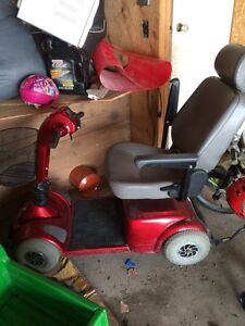 Electric red wheelchair scooter