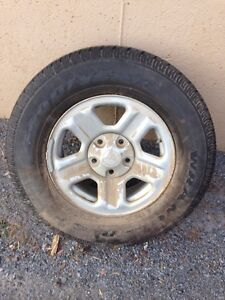 Wrangler stock spare tire,rim,cover and all mounting hard where