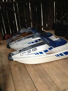 Two jet skis and double trailer