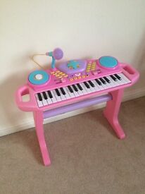 Kids pink piano keyboard toy instrument