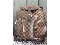 Louis Vuitton back pack.