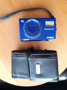 Blue Nikon Coolpix digital camera with case