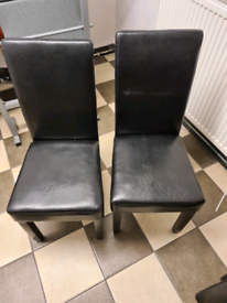 4 black leather chair and 2 red leather chair