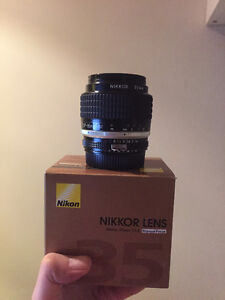 like new nikon AI S 35 1.4 prime lens in box
