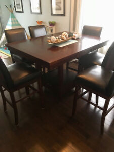 Dinning table and 6 leather swivel chairs