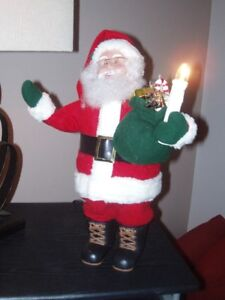 Santa he moves with a lighted candle
