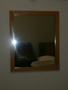 Mirror with nice wood frame.Tel 847 5097