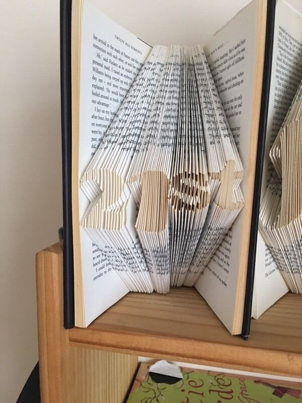 Book artin Portsmouth, HampshireGumtree - Book folding art. Folded by myself . Lovely present for a 21st birthday. Other numbers available