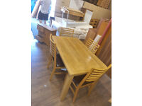 55. Light oak table and chairs