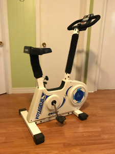 Exercise Bike and Weight Bench (with weights)