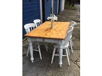 Farmhouse dining room table with four chairs