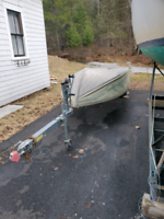 **Sold**14 foot aluminum boat and trailer $1700