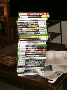 Xbox 360 4gb slim with two controllers and a bunch of games London Ontario image 2