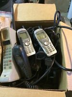 Box of old cell phones and chargers