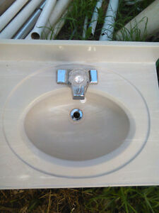 marble sink and faucet , salvaged , good cond.