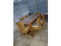 Solid pine dining table with 6 cane chairs
